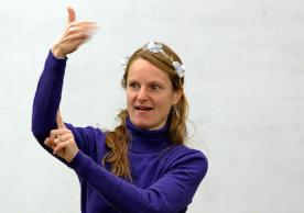 Jessica Tanner, instructor of the new ASL course at Yale, is shown signing in class.