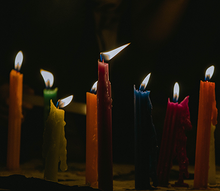 Lit candles of different colors